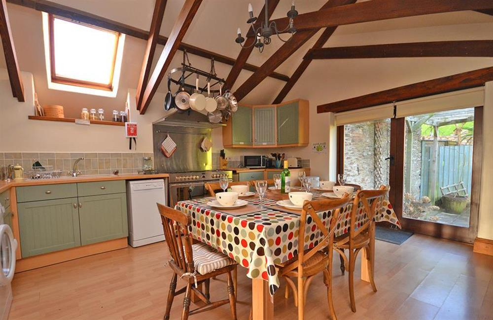 The spacious dining kitchen with doors opening into the garden at The Old Dairy, East Allington