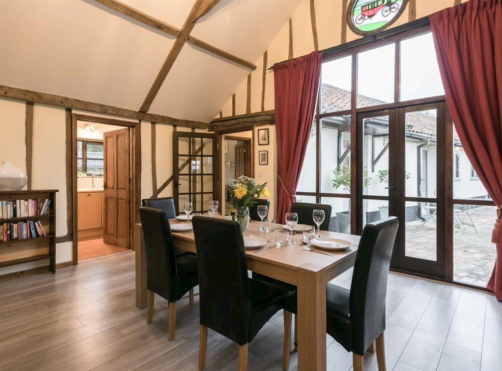 Accommodating dining room at The Old Hall Coach House in Tacolneston, near Wymondham, Norfolk