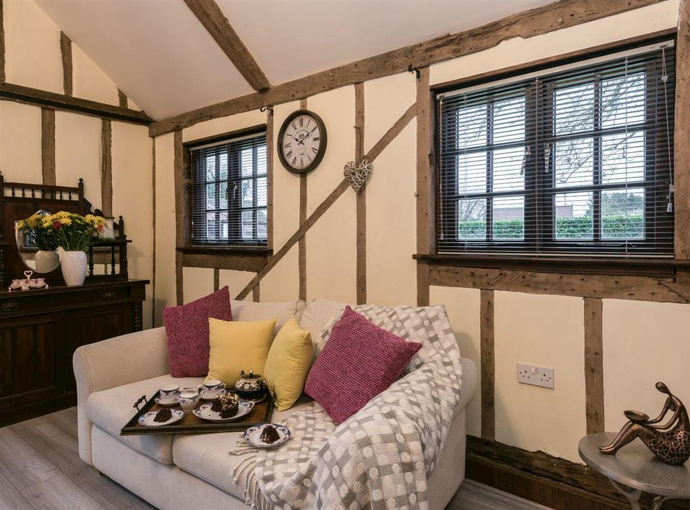 Cosy living / dining room at The Old Hall Coach House in Tacolneston, near Wymondham, Norfolk