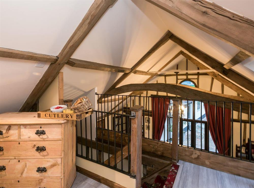 Galleried kingsize bedroom at The Old Hall Coach House in Tacolneston, near Wymondham, Norfolk