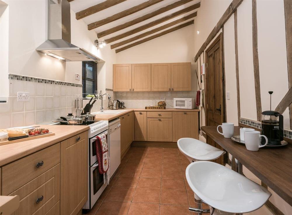 Kitchen with breakfast area at The Old Hall Coach House in Tacolneston, near Wymondham, Norfolk