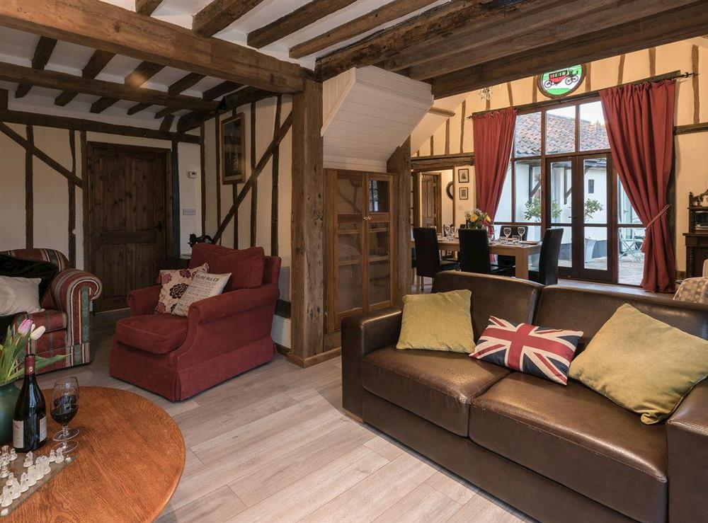 Sumptuous living room at The Old Hall Coach House in Tacolneston, near Wymondham, Norfolk