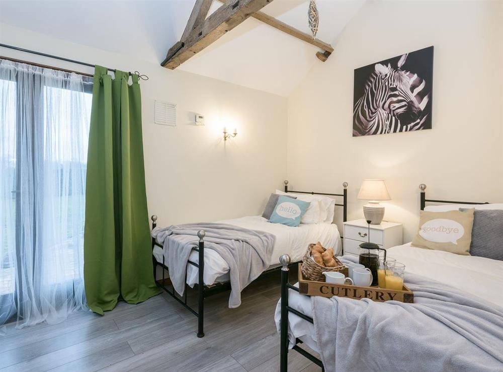 Twin bedroom at The Old Hall Coach House in Tacolneston, near Wymondham, Norfolk