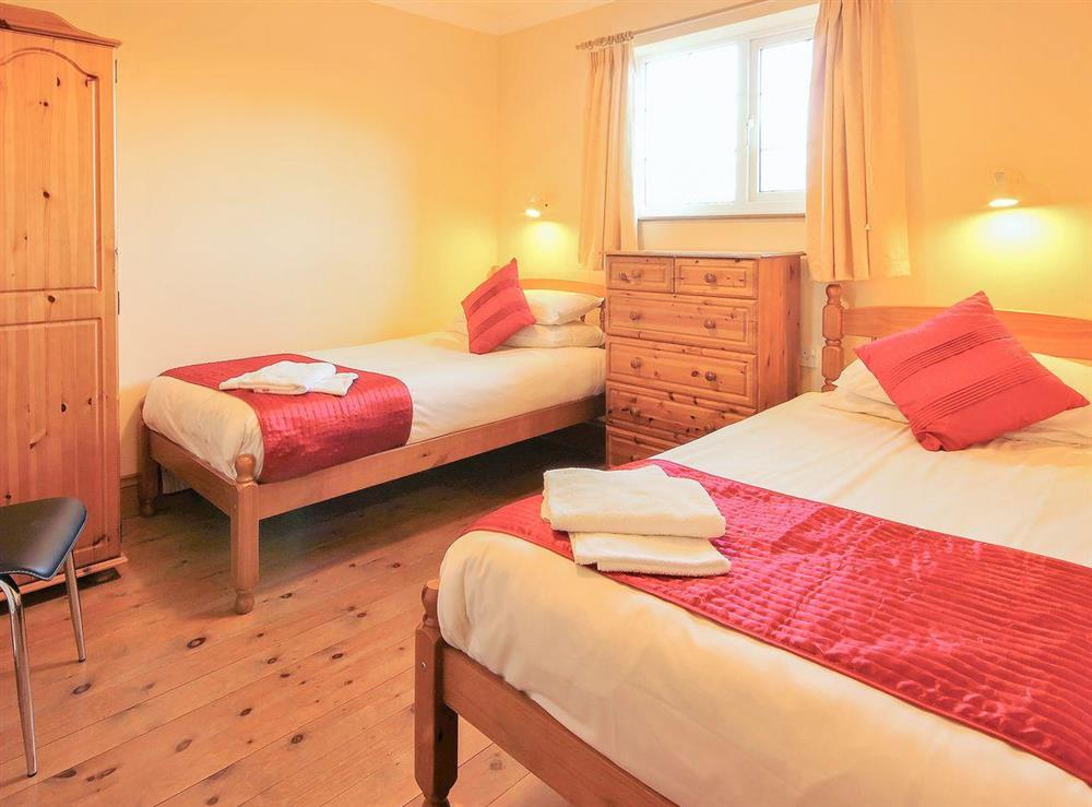 Twin bedded room with wooden floor at Sweet Coppin,
