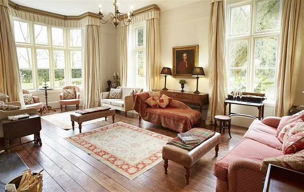 Ground floor:  Large drawing room with open fire at The Old Rectory, North Tuddenham