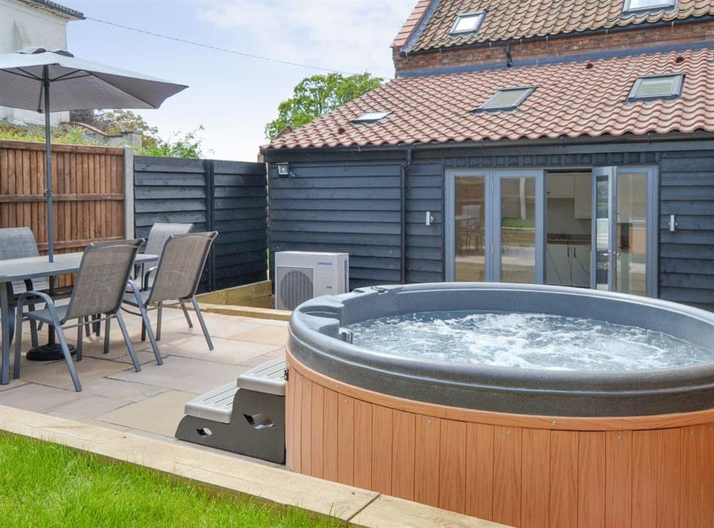 Enclosed rear garden with hot tub at The Old Stables in Swafield, near North Walsham, Norfolk