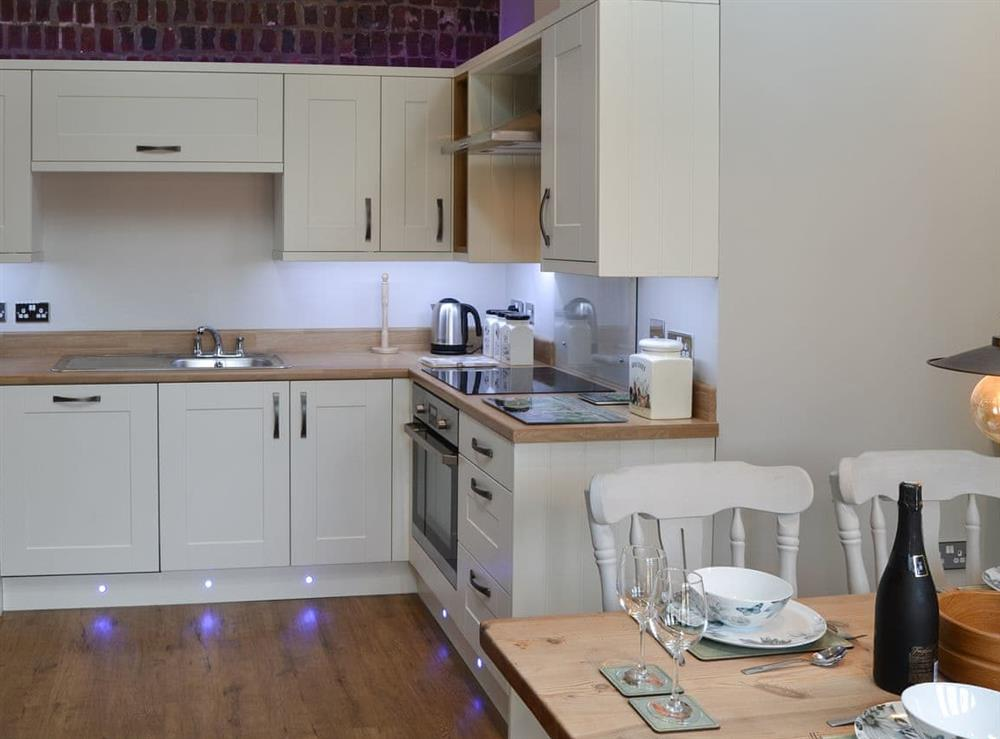 Kitchen with dining area at The Old Stables in Swafield, near North Walsham, Norfolk