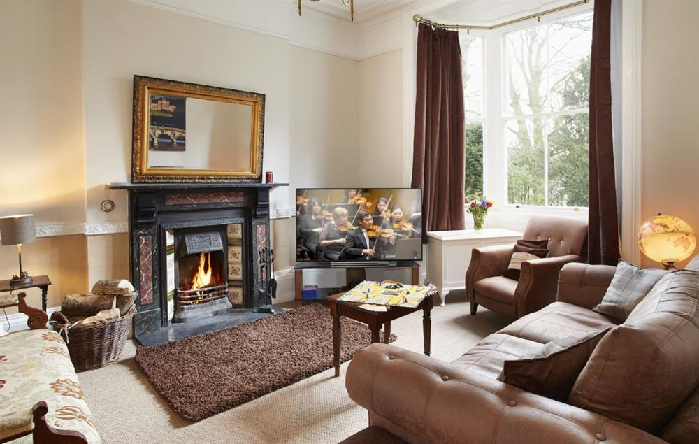 Ground floor: Sitting room with open fireplace