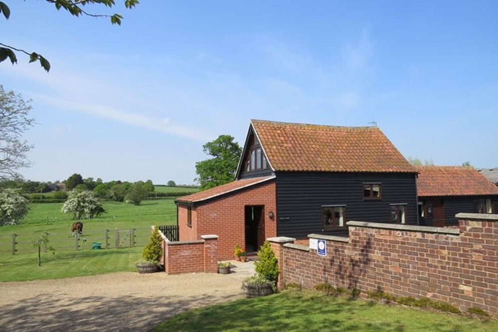 The outside of Henrys Barn at Old Hall Farm Cottages, Walpole, near Halesworth, Suffolk