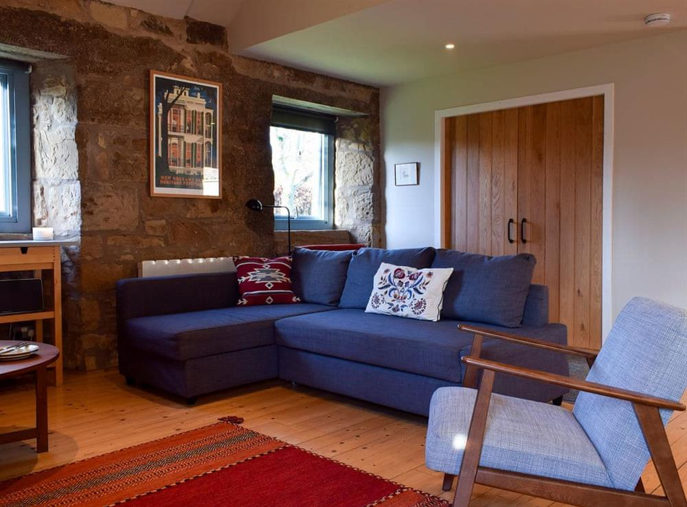 Cosy living room with wood burner at The Outside Room in Near Ladybank, Cupar, Fife