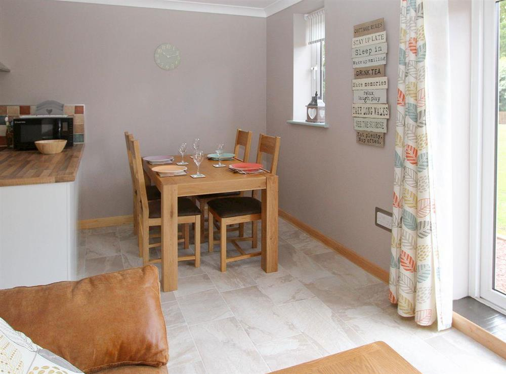 Convenient dining area at Woodpeckers Nest,