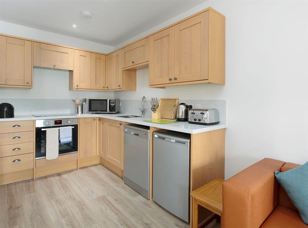 Well-equipped fitted kitchen at Crested Grebe,
