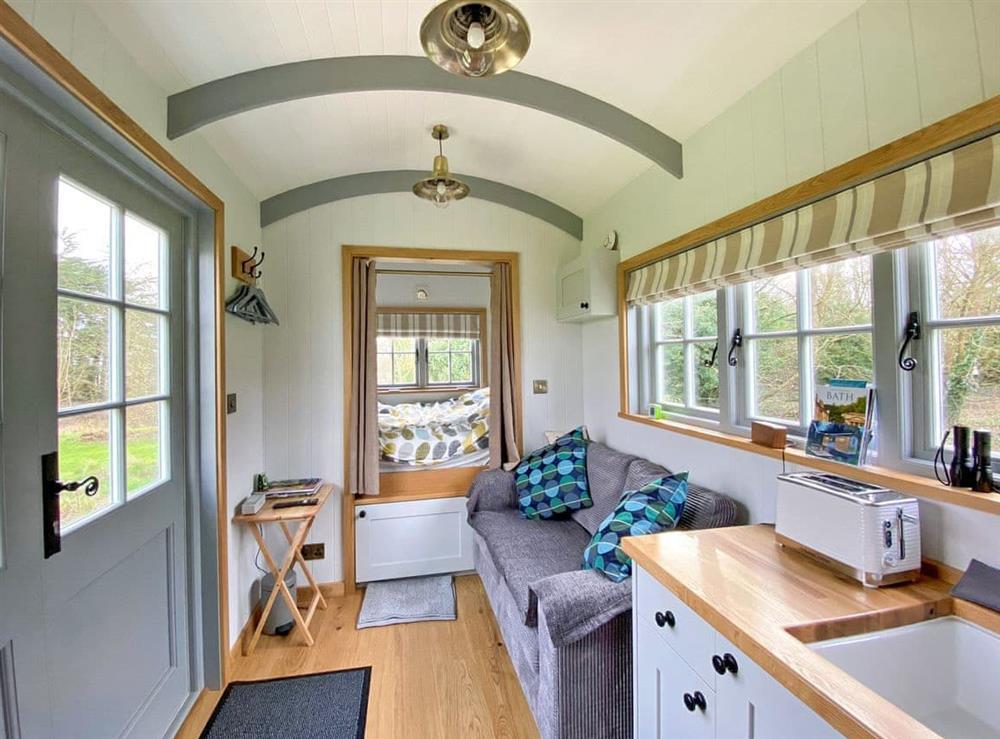 Open plan living space at The Shepherds Hut in Southstoke, near Bath, Avon