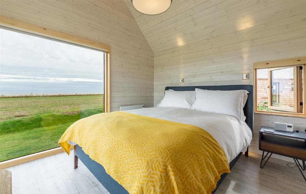 King size bed, sea views and en suite with bath and overhead shower at The Watch Houses, Reydon