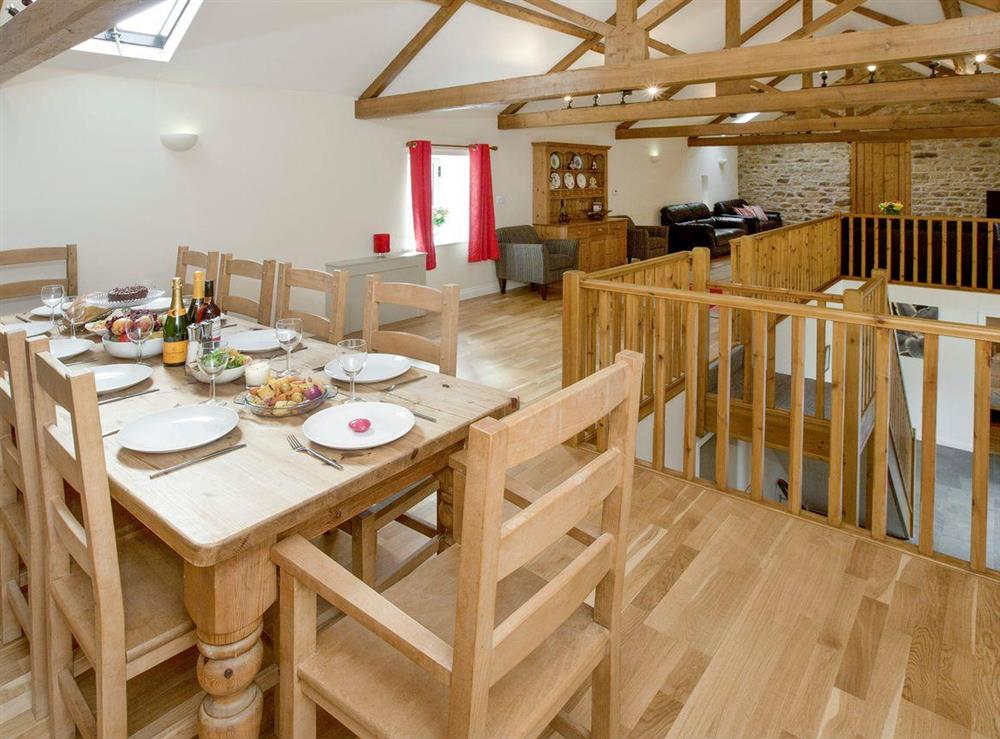 Large dining area with open aspect to seating area at Sycamore Cottage,