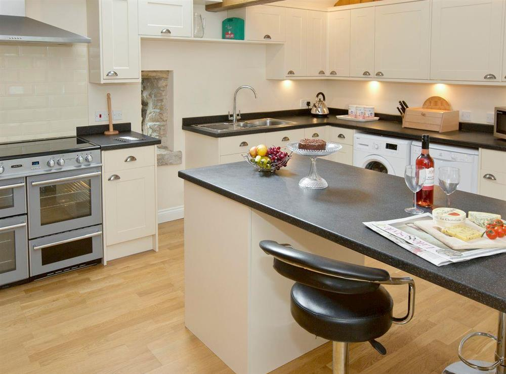 Modern fitted kitchen with 'breakfast bar' at Sycamore Cottage,