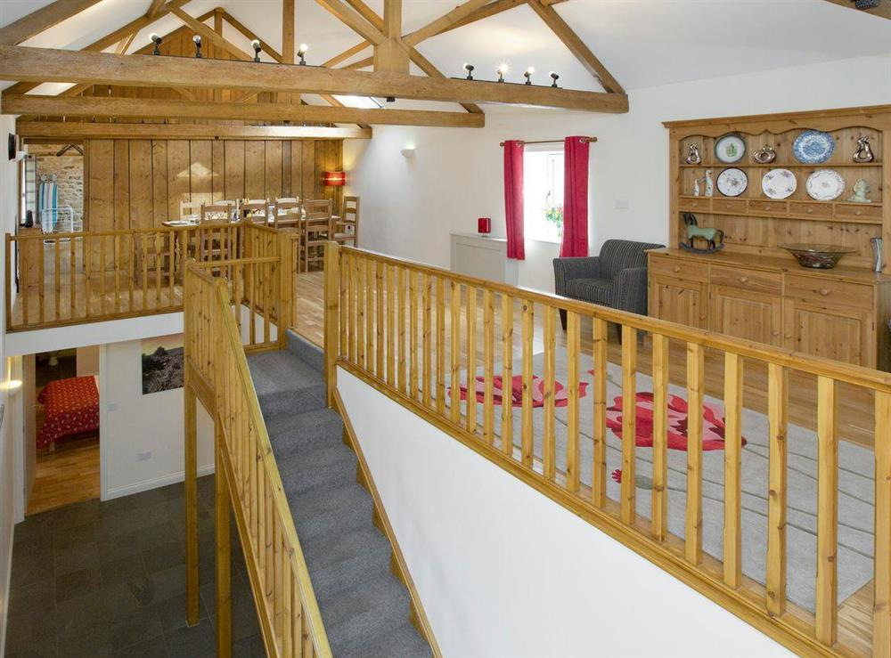 Open plan living area with stairs down to ground floor bedrooms at Sycamore Cottage,