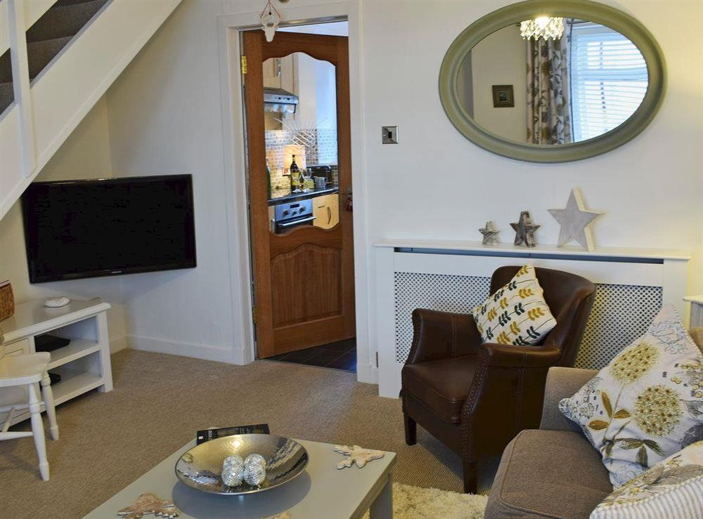 Warm and welcoming living room at Thistle Cottage in Crieff, Perthshire, Scotland