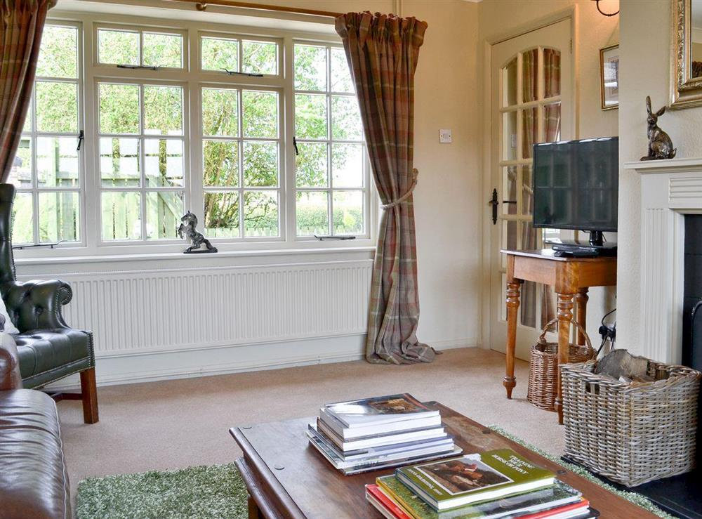 Cosy living room with open fire at Tickton Hall Cottage in Tickton, near Beverley, North Humberside