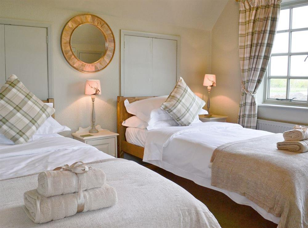 Cosy twin bedroom at Tickton Hall Cottage in Tickton, near Beverley, North Humberside