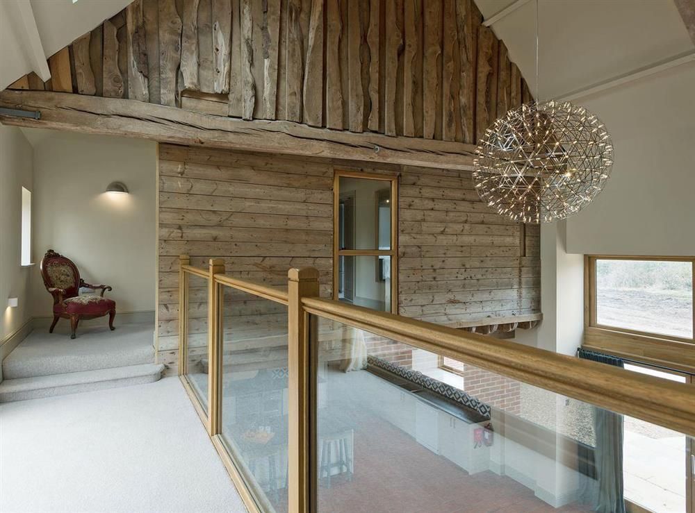 Light a airy landing with impressive high ceiling at Peak Hall,