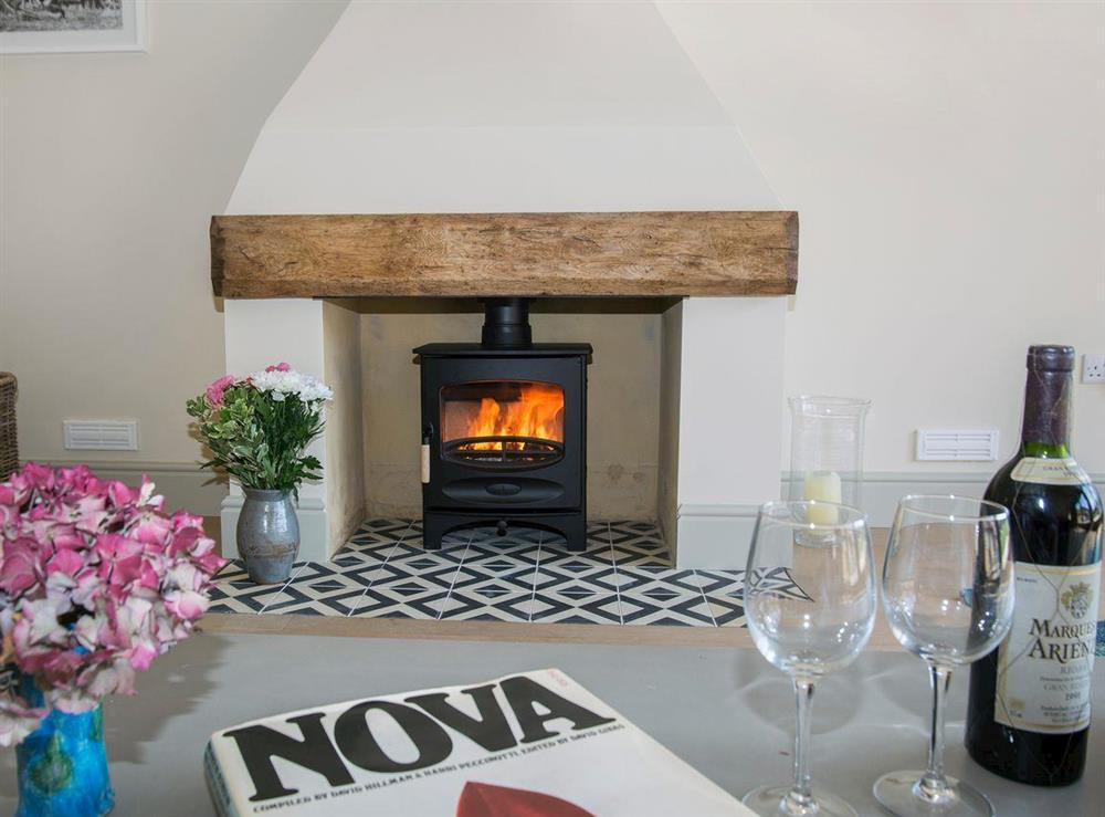 Cosy wood burner at Raynham Breck,