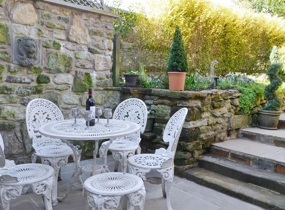Paved patio area with outdoor furniture
