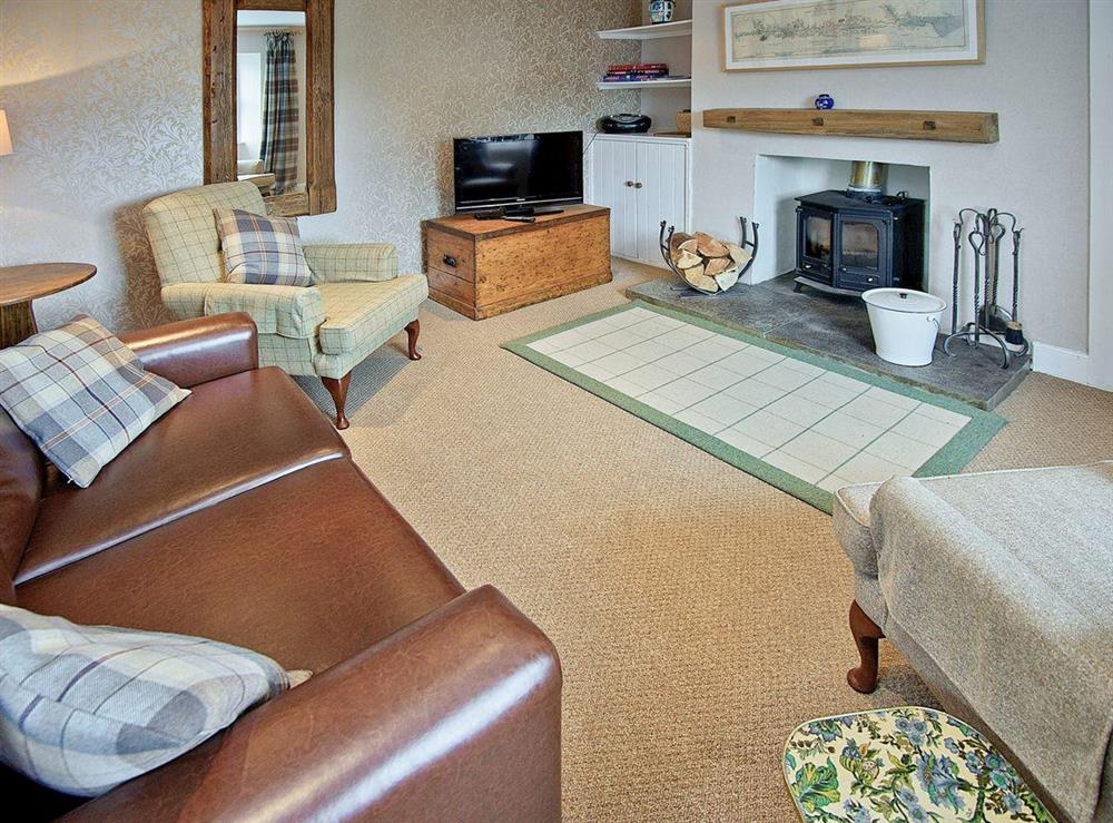 Charming lounge with wood burner at Tomnahurich Bridge House in Inverness, Inverness-Shire