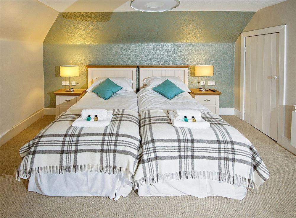 Relaxing twin bedroom at Tomnahurich Bridge House in Inverness, Inverness-Shire