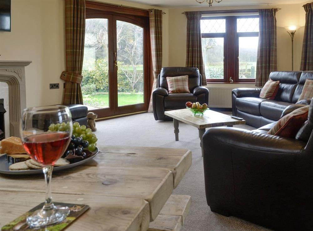 Stylish living area with French doors to garden at Trebor in Annan, near Carlisle, Dumfriesshire