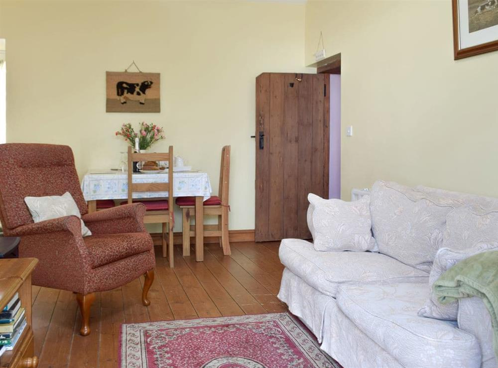 Attractive living and dining room at Crofters Cottage,