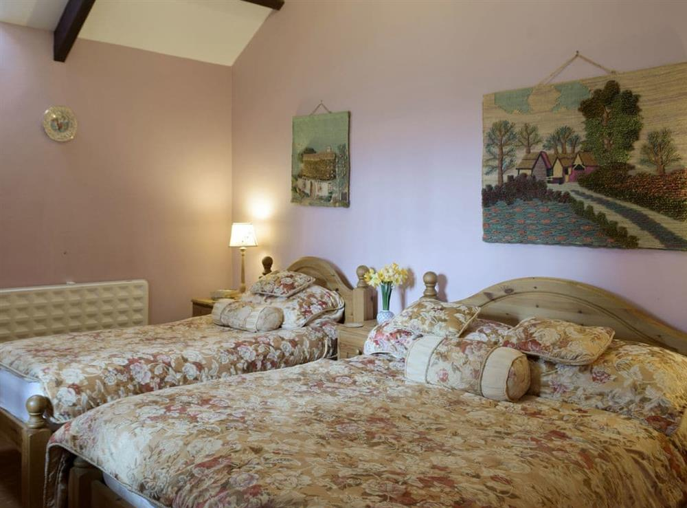 Bedroom with a double and a single bed at Crofters Cottage,