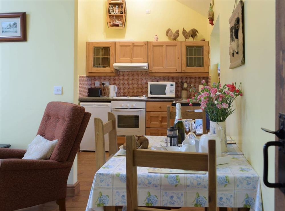 Convenient dining area with open-aspect to the kitchen at Crofters Cottage,