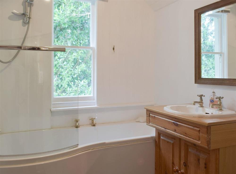 Family bathroom with shower over bath at Little Box,