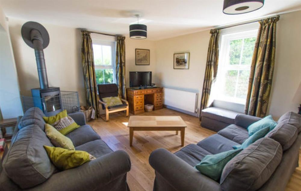 Ground floor:Sitting room with wood burning stove