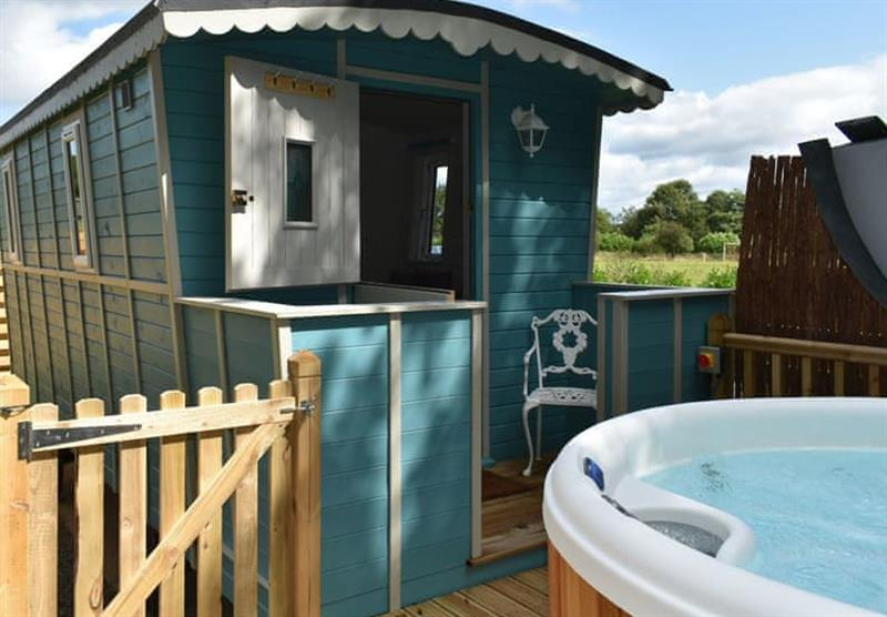 Outside the Llety Bugail, with its hot tub at Twin Rivers in Welshpool, Powys
