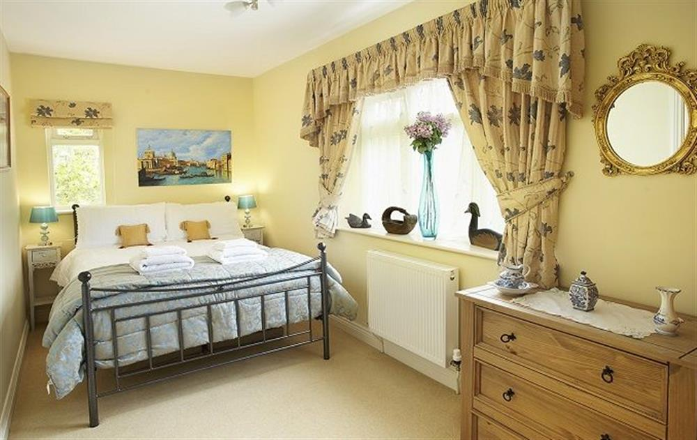 First floor: Back bedroom with a 4'6 bed at Underwood House, East Knoyle