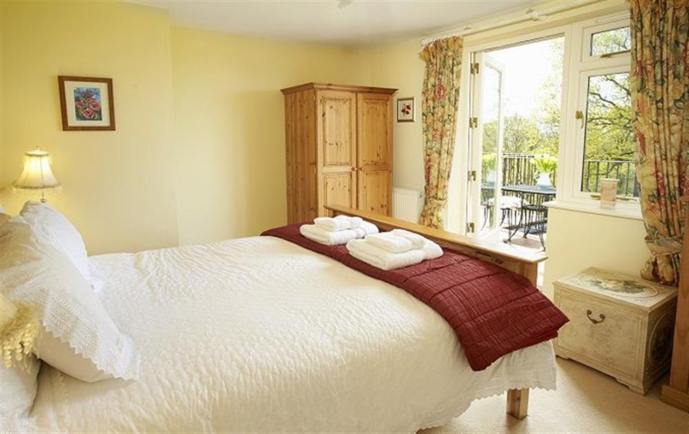 First floor: Double bedroom with 5' bed and patio doors leading onto the balcony at Underwood House, East Knoyle