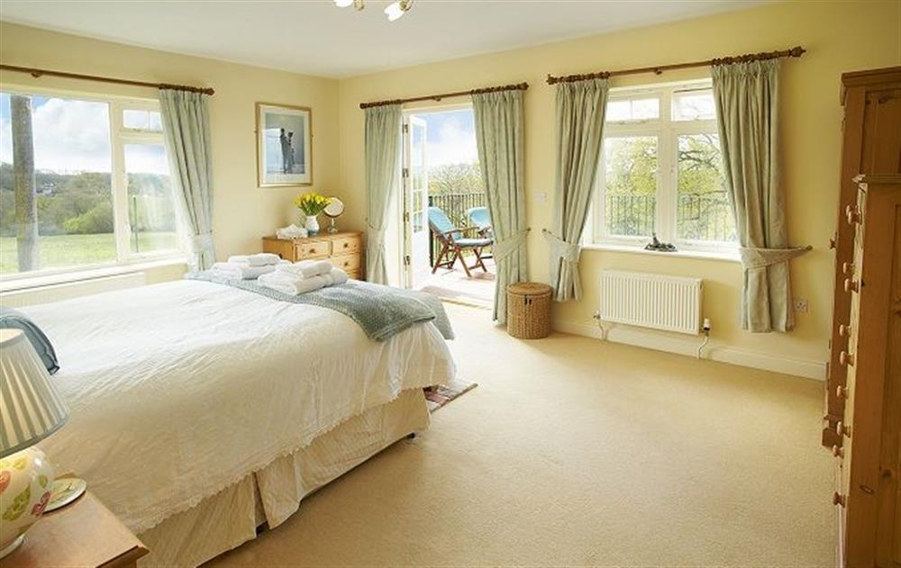 First floor: Second large master bedroom with 5' bed and patio doors leading onto the balcony (photo 2) at Underwood House, East Knoyle