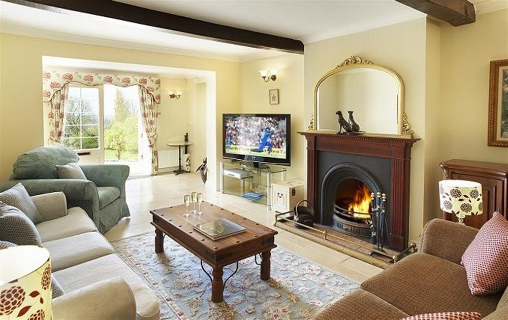 Ground floor:  Second sitting room with open log fire  at Underwood House, East Knoyle