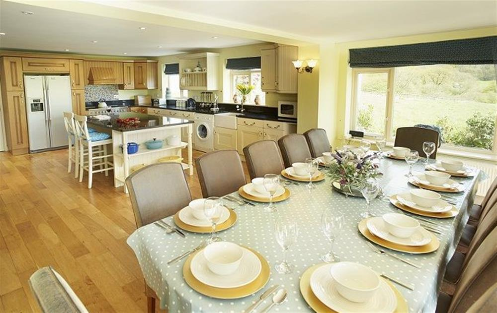 round floor: Stunning 40ft farmhouse kitchen/dining room with seating for twelve guests with spectacular views over the meadow