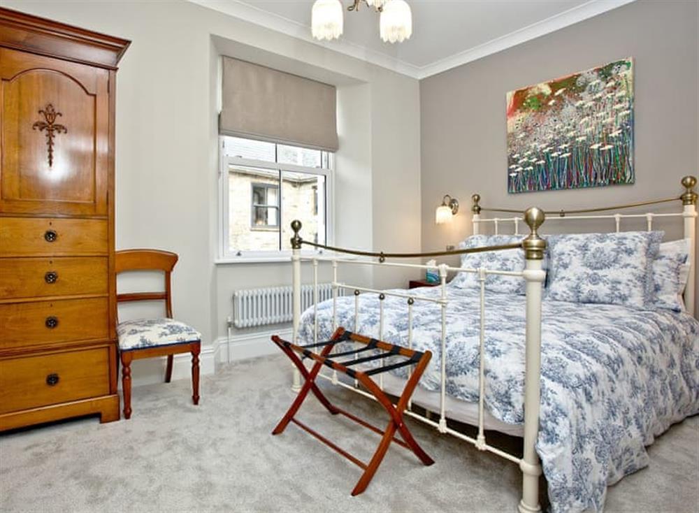 Welcoming double bedded room with antique style bed