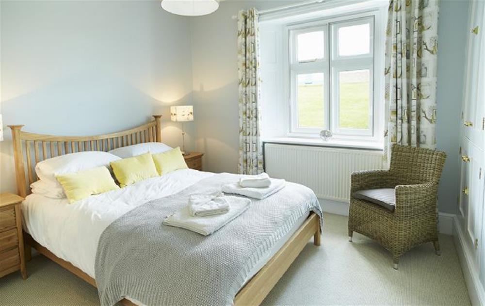 Ground floor: Double bedroom with 5' bed (photo 2) at Veronica Cottage, Anvil Point Lighthouse
