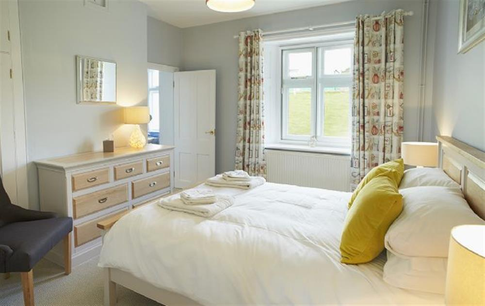 Ground floor: Double bedroom with 5' bed at Veronica Cottage, Anvil Point Lighthouse