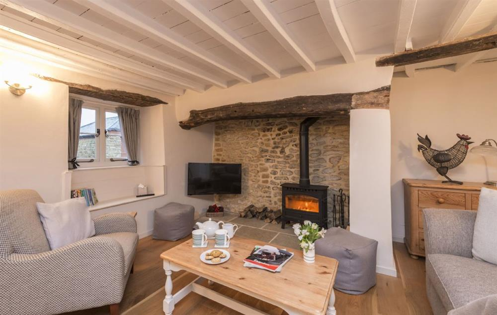 Ground floor: Sitting room with wood burning stove and exposed beams