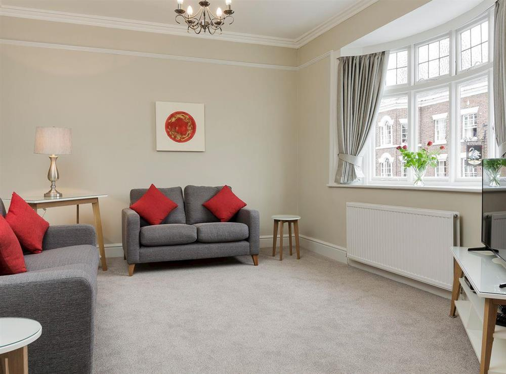 Bright and airy living room area at No 1 Victoria Apartment,