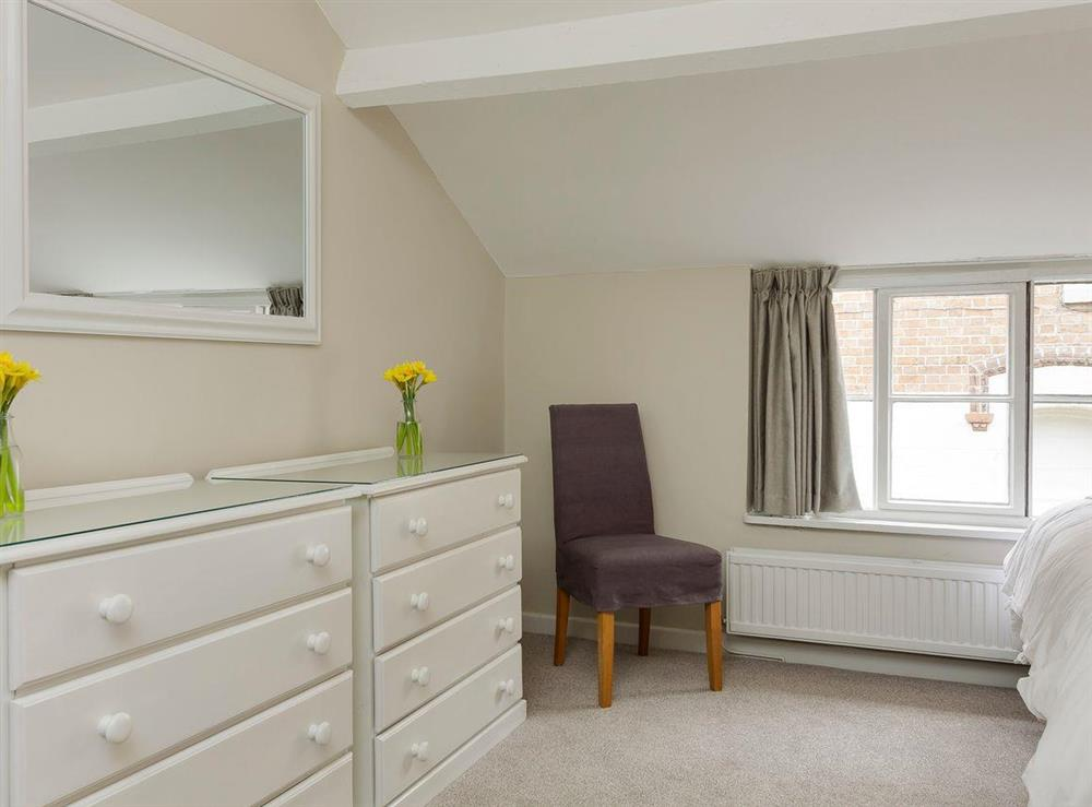 Comfortable bedroom with two double beds (photo 2) at No 1 Victoria Apartment,
