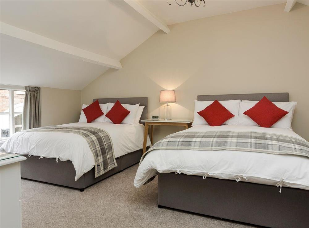 Comfortable bedroom with two double beds at No 1 Victoria Apartment,