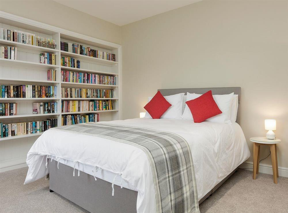 Stylishly furnished double bedroom with kingsize bed at No 1 Victoria Apartment,