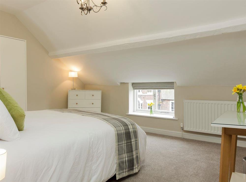 Charmingly furnished double bedroom with kingsize bed at No 2 Victoria Apartment,